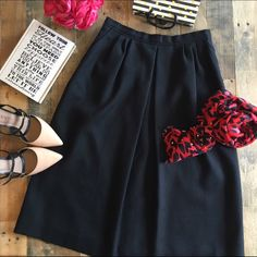 """Vintage black skirt . Host Pick  A beautiful classy midi skirt with some fullness to it. Two pockets and black zip. Linen-like material 50% polyester, 50% rayon with lining. Waist 13.5"""", length 27.5"""", no size tag. Scarf poshed from @lesliehuck! Host pick by @harmonyh 10/5 Back to Basics Party  Evan Picone Skirts Midi"""