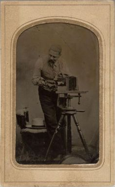 ca. 1865, [tintype portrait of a photographer with his camera] via the National Portrait Gallery, Smithsonian Institution
