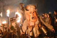 "Bulgarian dancers named ""Kukeri"" hold torches as they perform a ritual dance during the Kukeri Carnival in the village of Batanovci, western Bulgaria, on Sunday. The Kukeri Carnival is a festival of brightly colored wooden masks and costumes that marks… Ritual Dance, Pagan Festivals, Up Book, My Land, Wild Ones, In This World, Clouds, Pictures, Costumes"