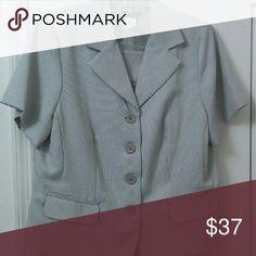 Courtenay Short Sleeved Business Suit Short sleeved jacket. Knee length skirt with splits. Courtenay Dresses