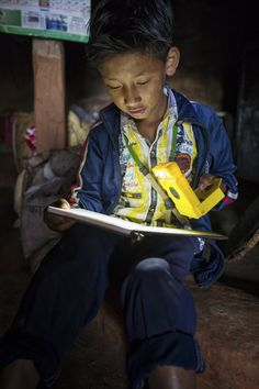 Share the Sun! Buy a WakaWaka. Give a solar light to a family caught in crisis and living without access to electricity. (Photo by Daniel Maissan)