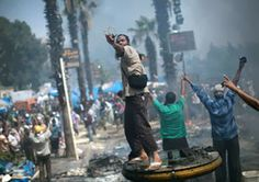 A supporter of ousted Islamist President Mohammed Morsi shoots a slingshot against Egyptian security forces during clashes in Rabaah Al-Adawiya in Cairo's Nasr City district, Egypt, Wednesday, Aug. Gil Scott Heron, Ike And Tina Turner, Kid Cudi, Criminal Justice System, James Brown, Jimi Hendrix, Cairo, Rock Music, Graphic Design