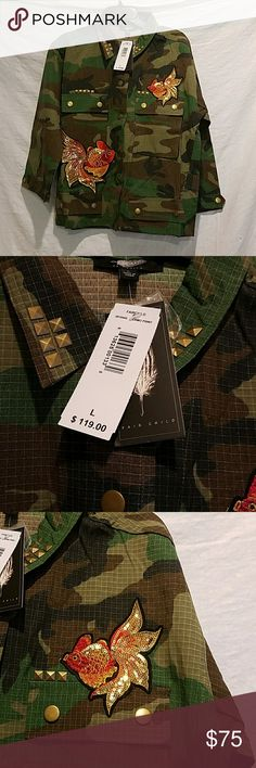 Camouflage jacket with patches Fair Child camo jacket with patches. Stud details on the collar and pockets. Sequined fish patches on the front and on the back. Jacket is about 25 inches long from shoulder down. There are two big functional pockets at the top front and two decorative pockets at the bottom. 51% rayon, 49% polyester. Fair child Jackets & Coats