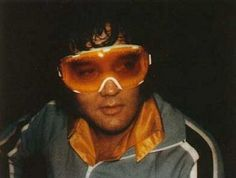 Photo was shot during Elvis' vacation to Aspen, Colorado in 1976. Maybe he wore them snowboarding around