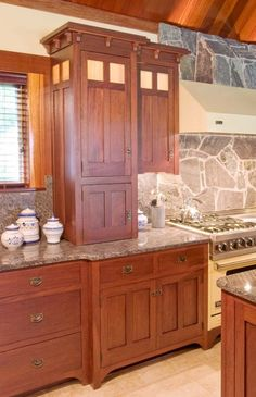 Mission Style Kitchen Cabinets | Top cabinet doors are a cross design. Glass in top cabinet doors.