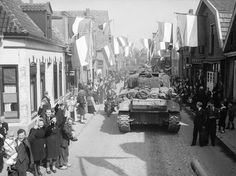 Civilians greet Canadian troops of the Fort Garry Horse and the Régiment de Maisonneuve, 9 Apr. 1945, Rijssen, Netherlands