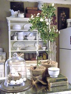Vintage display - love the white porcelain pieces, and table decor in this photo