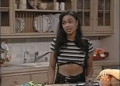 Ashley Banks 90s fashion high waisted black jeans and striped crop top.