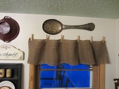 This would be cute in a laundry room. Burlap Garland No Sew Valances www.organizedclutterqueen.blogspot.com