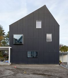 Corrugated metal cladding on house. Private House Bellmund by EXH Design