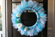 Pretty tulle wreath at a Frozen girl birthday party! See more party planning ideas at CatchMyParty.com!