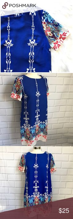 "Gi Biu Blue Shortsleeve Dress Gorgeous dress! Blue with pattern. Shortsleeves, zipper up back. 100% polyester. Size medium. Length from shoulder to hem approx 34"". Armpit to armpit laying flat approx 19.5"" GI BIU Dresses"