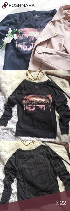 "nwot// • ae long sleeve graphic tee •ae •nwot •long sleeve graphic tee  •""city of dreams"" printed in gold lettering on front pattern •colors include: grey, pink, mauve, white and gold •color is truest in last 3 pics •size xs  •material: 60% cotton, 40% modal (a type of rayon)  •please see all pics, read description, and ask questions before purchasing   •no trades• •reasonable offers welcomed• •10% off 2+ items• American Eagle Outfitters Tops Tees - Long Sleeve"