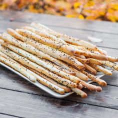 Bread sticks (Grissini) 300 ml lukewarm water 1 tsp sugar 1 packet or 2¼ tsp active dry yeast 3 to 3½ cups all purpose flour (you can use whole wheat flour for these) 3 tbsp vegetable oil 1 tsp salt 1 egg white (for brushing) ¼ cup sesame seeds   Read more: http://www.jocooks.com/bakery/breads/bread-sticks-grissini/#ixzz3AtRxuwh2