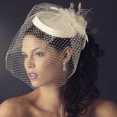 Complete the finishing touch to your vintage wedding theme with this high fashion couture bridal hat and russian birdcage veil accent. This accessory features a dainty haute that has an accenting rim