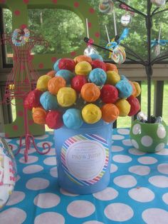 This bouquet of cake pops doubles as colorful decor! #kidsparty #partyidea