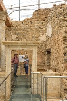 marble door at terrace houses - tourists behind a beautiful marble door at terrace houses in ephesus.a huge site within ephesus,the terrace houses give us a good idea about how the wealthy people lived 2,000 years ago.ephesus is a unesco World heritage site since 2015.