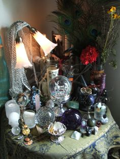 A divination altar piled with crystal balls, candles, and scarf-draped lamp. Crystal Altar, Crystal Ball, Crystal Sphere, Magick, Witchcraft, Pagan Altar, Wiccan Decor, Tarot, Meditation Space