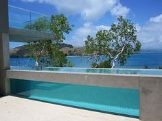 Love this acrylic window with the concrete beam over the top. Pinned onto Pool Design by Darin Bradbury.
