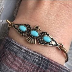 "2/$20 HOST PICKThunderbird Hook Bracelet Native American style thunderbird bracelet. Brass tone/color. Faux turquoise accents. Hook and loop open and closure for easy on/off. Approximate 7"" circumference. Fashion/costume jewelry. Brand new with tag. No trades, no holding, no offsite payment.       PRICE IS FIRM UNLESS BUNDLED       No offers entertained for any reason                  $12 jewelry is 2/$20  Jewelry Bracelets"