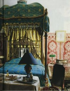 Rich colors, patterns, and forms create a very moody yet luxurious bedroom