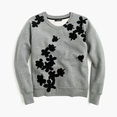 "A cozy sweatshirt plus graphic flowers. Because even the easiest pieces deserve a little something extra. <ul><li>Slightly loose fit.</li><li>Body length: 23 3/4"".</li><li>Cotton.</li><li>Machine wash.</li><li>Import.</li></ul>"