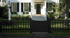 Fences need not always be white. Experiment with other colors for a new, creative twist. The green undertones of midnight (2131-20) on this fence splendidly coordinate with the dark green front door and the surrounding foliage. Simulating wrought-iron, the fence color creates a clean contrast and gives the property a formal, elegant style.