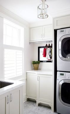 Style at Home: Contemporary laundry room with stacked white front-load washer & dryer, shaker cabinets ...