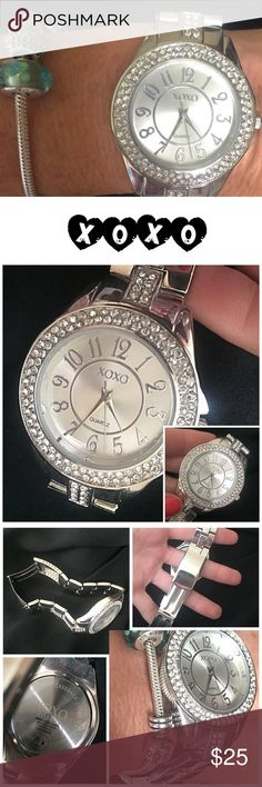 """XOXO silver plated watch XOXO brand silver plated boyfriend watch with no defects but missing a battery. of wear. Wide rhinestone embellished face. Clasps underneath. Stainless steel case back and still has sticker with directions for battery installation. Flat face is 1.5"""" my wrist is 6"""" around and watch clasped is approximately 7"""" long💖 XOXO Jewelry"""