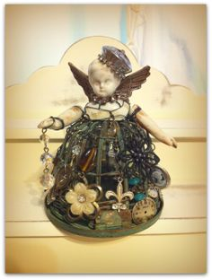 The littlest Junk Jar doll I have made. she opens up for a flickering battery operated light to fit inside