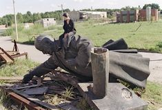 A young Lithuanian girl sits on the toppled statue of Russian Bolshevik revolutionary leader Vladimir Lenin in Vilnius after the monument was removed from the center of the Lithuanian capital, on September (Gerard Fouet/AFP/Getty Images) Rare Historical Photos, Fidel Castro, The Uncanny, Rare Pictures, Street Art, Around The Worlds, Vladimir Lenin, September 1, Monuments