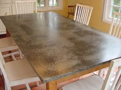 We take a sheet of zinc, copper, or galvanized steel, patinate the metal for that aged or vintage look and then form it to fit over your table top. Concrete Table Top, Metal Top Table, Metal Tables, Metal Countertops, Zinc Table, Diy Table Top, Kitchen Redo, Kitchen Island, Kitchen Worktops