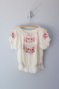 Vintage 1940s sheer white hungarian boho blouse with amazing rainbow embroidered floral details, small pink tie at neck and gathered waist. ✂ ✂ ✂ M E