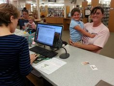 Mom's getting Madison her first library card!