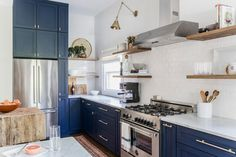 About to undertake a dramatic kitchen renovation? Here's how one designer completely reshaped the layout of her home to transform a bathroom and lounge area into a chic kitchen. For more before & after renovations, go to Domino. Kitchen Buffet, New Kitchen, Kitchen Dining, Kitchen Cabinets, Blue Cabinets, Kitchen Ideas, Kitchen Updates, Kitchen Floor, Kitchen Paint