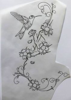 Calque colibri et fleurs de cerisier - essais pour un pied. Réalisé par Sylvaine du studio Syltattoo.