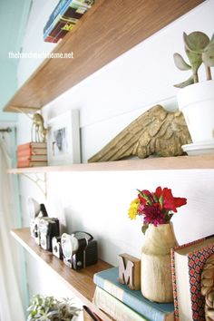 243405554833966696 Beautiful Stained Shelving & Gold Brackets