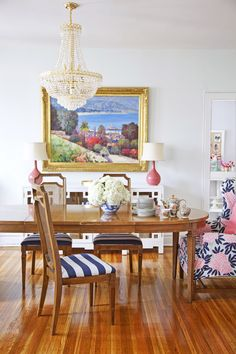Adore Home magazine - Blog - Caitlin Wilson's beautifulhome.  Love her colorful home and pretty textiles.  Oil painting, crystal chandelier, floral print, coral, traditional dining set.