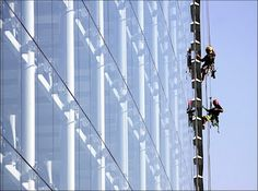 Employees clean the windows of the main building of the European Parliament in Strasbourg.