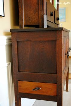living room. black walnut cupboard detail. side drawer.
