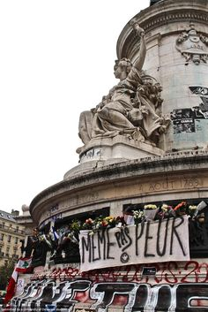 This photo was taken in Paris at Place de la République after the terrorist attacks in November, 2015. The memorial for the victims was set up at Place de la République, which is located near the Bataclan Theater and the restaurants that were attacked. I feel that this picture is very symbolic of the French sentiment and strength after the terrorist attacks. Photo by Laura Woodward.