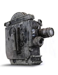 Rebecca Johnson and Jeff Klarin created really cool cameras, joysticks, turntables, and other gadgets made out of cement. It almost looks like fossils! Hand Cast, It Cast, Gadgets, Futuristic Art, Vintage Cameras, Everyday Items, Coups, Concrete, Cement