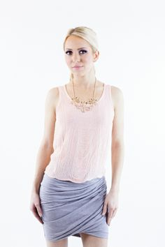 This is a solid knit fitted skirt with a high waist that gathers in the front for a more stylish look.