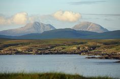 A June evening view across Sanaigmore Bay on Islay with the majestic Paps of Jura in the distance. The low evening sun creates some beautiful light on the Paps.