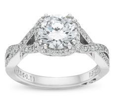 TACORI. Love the twist in the band, would be better if there was a hint of rose gold in there though