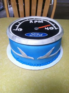 Ford Falcon Cake - A friend is nearing 40..Tachometer cake with falcons on the side. Color of his 1965 restored Falcon :)