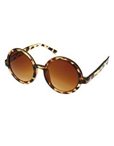 WANT THESE! It's all about the round sunglasses this summer!