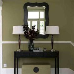 Olive green in the hall (bottom half). top half will be a cream color.