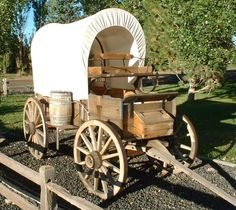 typical wagon for travelling the long road to the west-normally pulled by oxen- horses couldn't have withstood the strain.