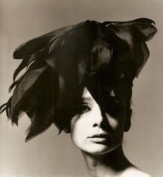 Audrey Hepburn. Purely dramatic hat and portrait. Dig the use of lighting and shadow on her face.